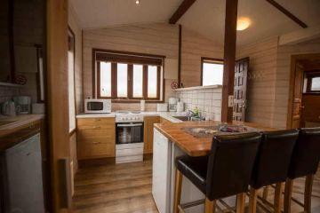 Küche im 2 Personen Cottage in den Hestasport Ferienhäuser, Island