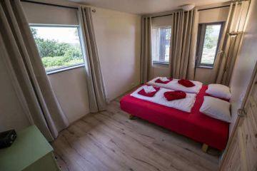 Schlafzimmer im 4 Personen Apartment in den Hestasport Ferienhäuser, Island